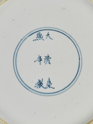 Lot 322 - A LARGE BLUE AND WHITE 'PRUNUS AND LINGBI' LOBED DISH, KANGXI MARK AND PERIOD