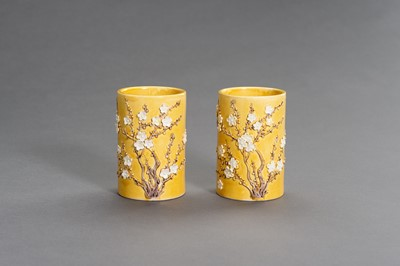 Lot 403 - A PAIR OF YELLOW GLAZED BRUSHPOTS WITH APPLIED DECORATIONS, LATE QING