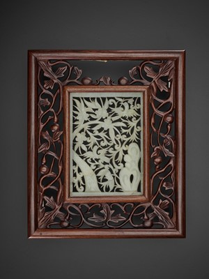 Lot 86 - AN OPENWORK JADE 'BIRDS AND FLOWERS' PLAQUE, MING DYNASTY