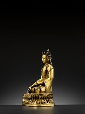 Lot 490 - A GILT COPPER-ALLOY FIGURE OF A CROWNED BUDDHA, MALLA, 14TH - 15TH CENTURY