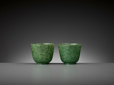 Lot 78 - A PAIR OF SPINACH-GREEN JADE CUPS, QING DYNASTY