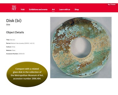 Lot 48 - AN AQUAMARINE GREEN GLASS BI DISK, HAN DYNASTY