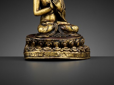 Lot 41 - A GILT BRONZE FIGURE OF A CROWNED BUDDHA, DATED 1709