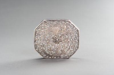 A RETICULATED SILVER LID WITH PHOENIXES