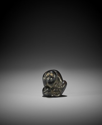 Lot 114 - A TSU SCHOOL EBONY WOOD NETSUKE OF A MONKEY