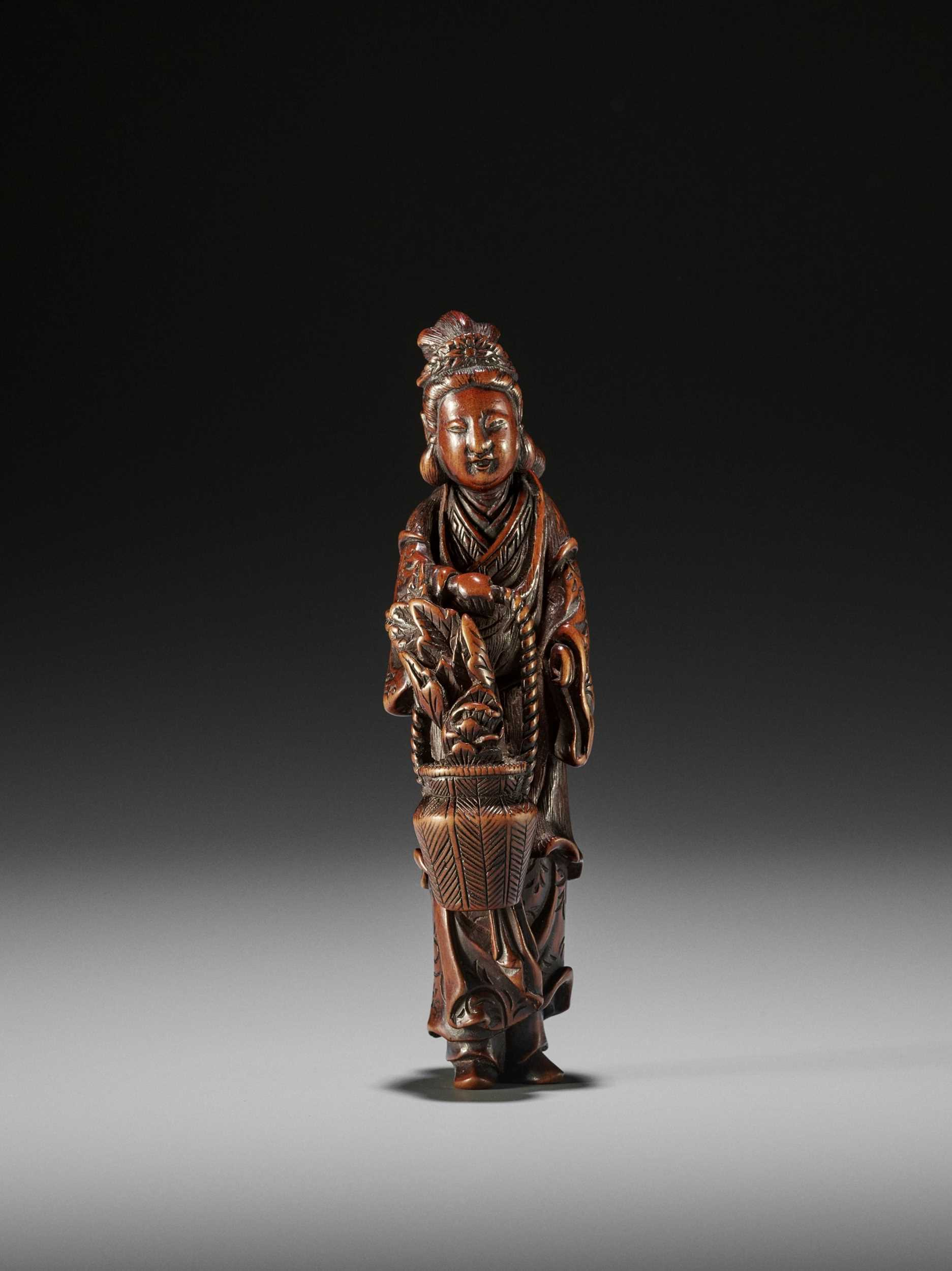 Lot 173 - HASEGAWA IKKO: A TALL AND FINE WOOD NETSUKE OF SEIOBO