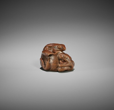 Lot 142 - ARIMA TOMONOBU: A LARGE NAGOYA SCHOOL WOOD NETSUKE OF THE SANSUKUMI