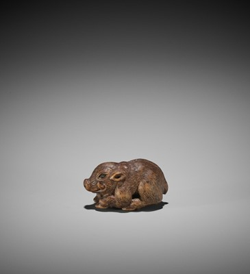 Lot 107 - MINKO: A RARE WOOD NETSUKE OF A RECUMBENT BOAR