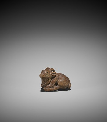 MINKO: A WOOD NETSUKE OF A RECUMBENT GOAT