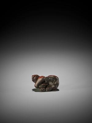 TADAYOSHI: A FINE WOOD NETSUKE OF A WOLF WITH VENISON HAUNCH