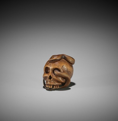 Lot 151 - SUKEYUKI: A MASTERFUL WOOD NETSUKE OF A SNAKE AND SKULL