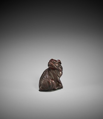 Lot 122 - TAMETAKA: A FINE WOOD NETSUKE OF A JAKONEKO