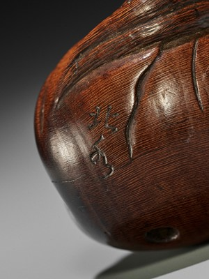 HOKUSUI: A WOOD NETSUKE OF DARUMA