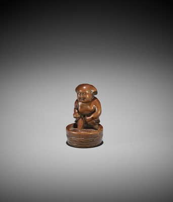 A WOOD NETSUKE OF OKAME STEPPING INTO A BATH, ATTRIBUTED TO MINKO