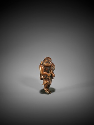 A GOOD WOOD NETSUKE OF HOTEI