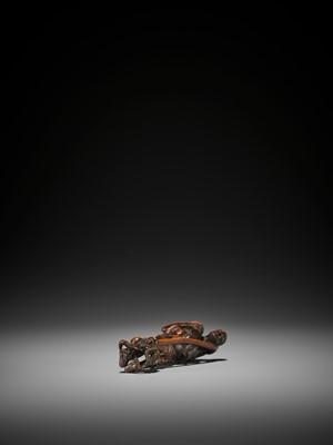 Lot 20 - KAZUHIDE: A TALL WOOD NETSUKE OF ASHINAGA AND TENAGA