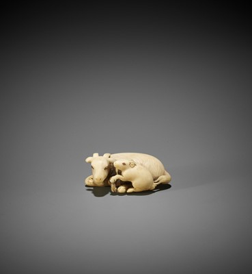 Lot 292 - TOMOKAZU: AN IVORY NETSUKE OF A GOAT WITH YOUNG