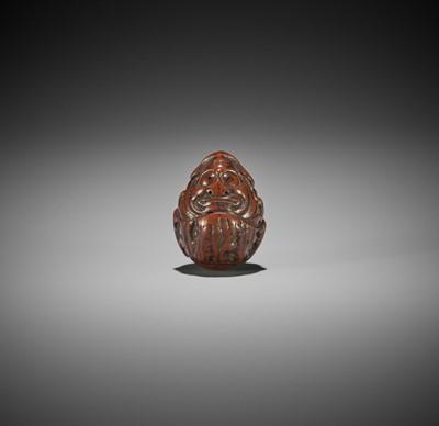 A KURUMI (WALNUT) NETSUKE OF DARUMA, ATTRIBUTED TO HIDARI ISSAN