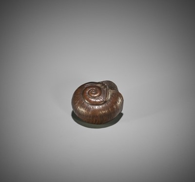Lot 143 - A NAGOYA SCHOOL WOOD NETSUKE OF A SNAIL