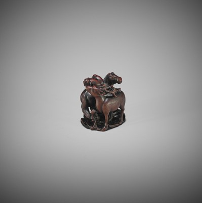Lot 183 - A WOOD NETSUKE-OKIMONO OF A DEER AND HORSE WITH SMALL MONKEYS