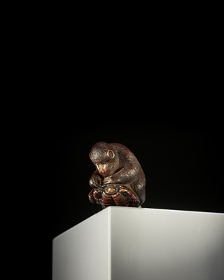 Lot 134 - A NAGOYA SCHOOL DARK WOOD NETSUKE OF A MONKEY ON TORTOISE
