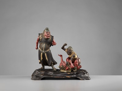 Lot 74 - A RARE MUROMACHI PERIOD POLYCHROME WOOD GROUP WITH SHOKI AND ONI