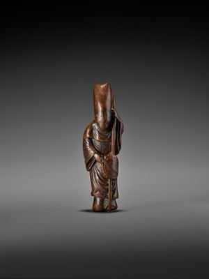 Lot 302 - A LARGE AND EARLY WOOD NETSUKE OF A CHINESE COURT OFFICIAL