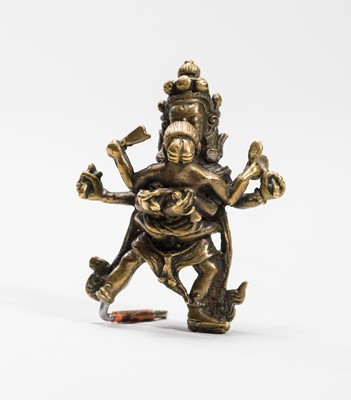 Lot 549 - A TIBETAN BRONZE OF A DHARMAPALA IN YABYUM WITH PRAJNA, 18TH-19TH CENTURY