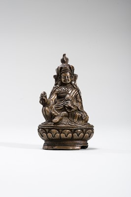 Lot 544 - A TIBETAN MINIATURE BRONZE OF PADMASAMBHAVA, 19TH CENTURY