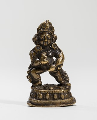 Lot 545 - A TIBETAN MINIATURE BRONZE OF KUBERA, 18TH-19TH CENTURY