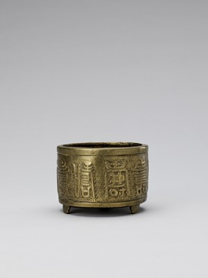 Lot 521 - A BRASS ALLOY TRIPOD CENSER WITH INSCRIPTION, QING