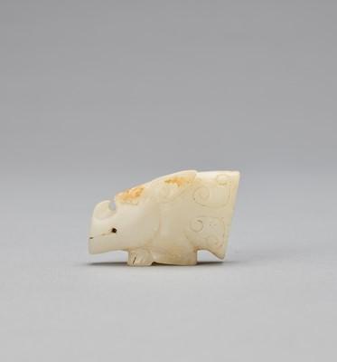 AN ARCHAISTIC WHITE JADE MYTHICAL BEAST HEAD, QING