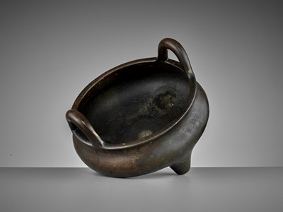 Lot 516 - A LARGE AND HEAVILY CAST BRONZE TRIPOD CENSER, 17TH CENTURY