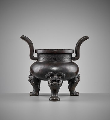 Lot 513 - A HEAVILY CAST BRONZE TRIPOD CENSER, MING DYNASTY