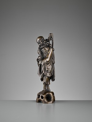 Lot 575 - A BRONZE FIGURE OF AN EMACIATED IMMORTAL, 17TH CENTURY