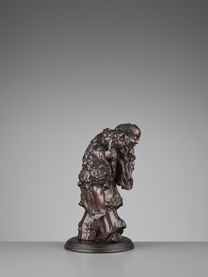 Lot 132 - A BURLWOOD CARVING OF LIU HAI, LATE MING TO EARLY QING