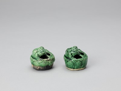 Lot 635 - A PAIR OF EMERALD GREEN GLAZED POTTERY BUDDHIST LION WATER DROPPERS, KANGXI