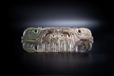 A LARGE 'TOOTHED' JADE PENDANT WITH MASK MOTIF, HONGSHAN