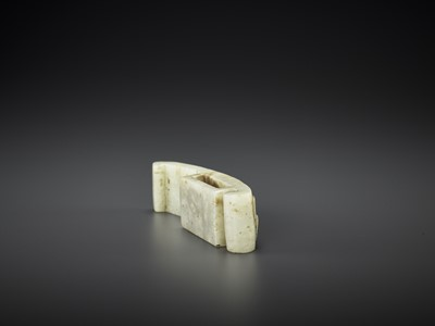 AN ARCHASITIC JADE SCABBARD SLIDE WITH DRAGON AMID CLOUDS, EARLY MING