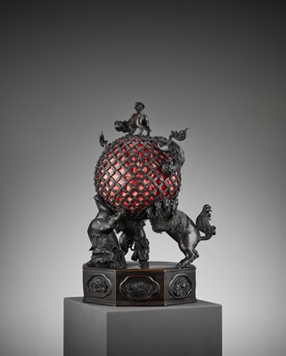 Lot 17 - A RARE TEMPLE LAMP OF BRONZE SHISHI SUPPORTING A BROCADE BALL