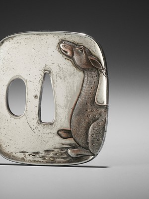 Lot 27 - A SILVERED TSUBA WITH A RECUMBENT DEER
