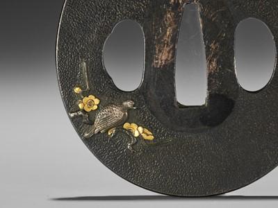 Lot 34 - A SHIBUICHI AND GOLD TSUBA