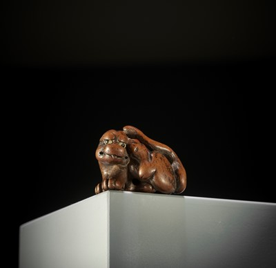 Lot 146 - SATO MASAYOSHI: A FINE WOOD NETSUKE OF A TIGER