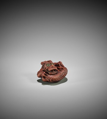 Lot 112 - MINKO: A RARE WOOD NETSUKE OF A COILED DRAGON