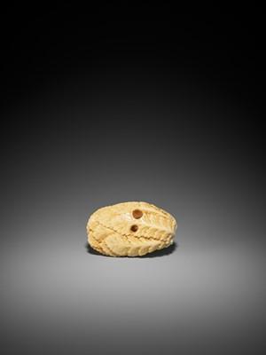 A RARE MARINE IVORY NETSUKE OF A RAT ON LEAFY DAIKON