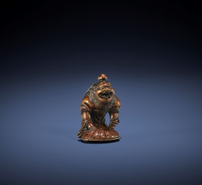 Lot 154 - A HUMOROUS HAKATA SCHOOL WOOD NETSUKE OF SHOKI AND ONI