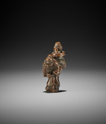 Lot 165 - SANKO: A WOOD NETSUKE OF SHOKI WITH ONI IN A BASKET