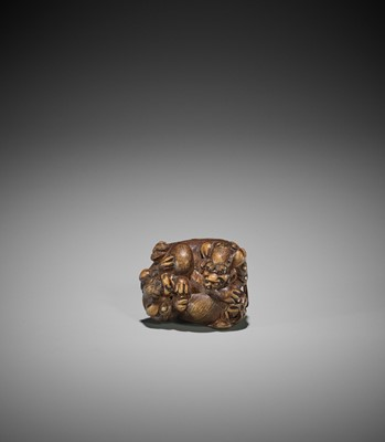 Lot 147 - SATO MASAYOSHI: A WOOD NETSUKE OF TWO SHISHI WITH BROCADE BALL