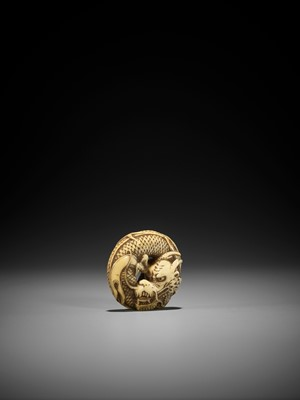 Lot 59 - A FINE WALRUS TOOTH MANJU NETSUKE OF A COILED DRAGON