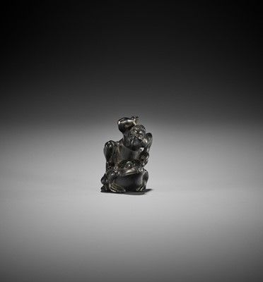 Lot 159 - NIZAN: AN EBONY WOOD NETSUKE OF TENJIKU TOKUBEI